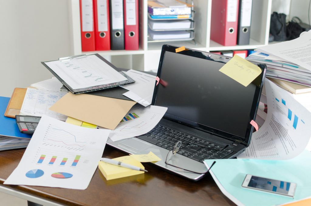 A messy desk is a distraction. Clean and organize it for greater focus and energy.